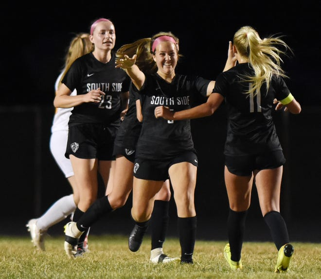 South Side's Maura Heberle (5) is congratulated by her teammates after scoring the second goal of the game against OLSH, Wednesday night at South Side High School.