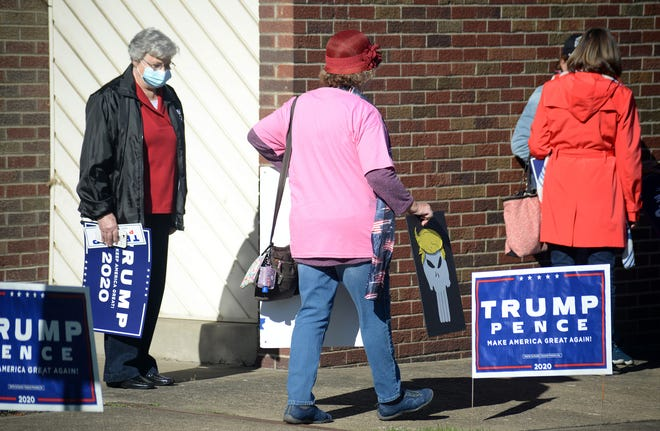 President Trump supporters carry their signs to the front of the Masonic Temple building in Bridgewater Thursday, waiting three hours for a glimpse of Lara Trump. A Times reporter and freelance photographer were asked by campaign officials to leave the event.