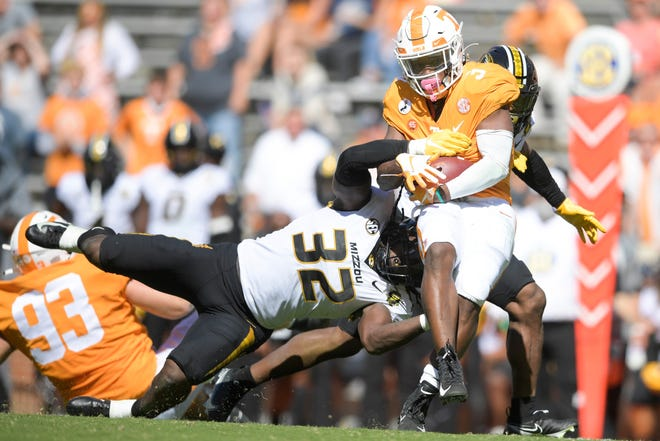 Missouri linebacker Nick Bolton (32) tackles Tennessee running back Eric Gray (3) during a Southeastern Conference game Oct. 3 at Neyland Stadium in Knoxville, Tenn.