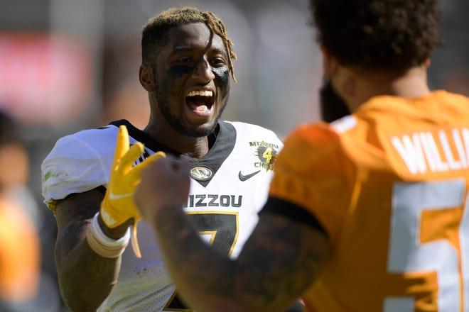 Missouri wide receiver Damon Hazelton (7) greets Tennessee defensive lineman Savion Williams (50) on Oct. 3 at Neyland Stadium in Knoxville, Tenn.