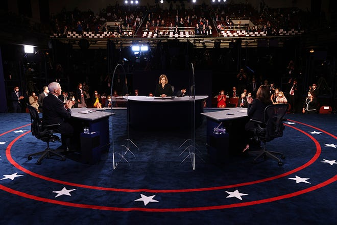 Vice President Mike Pence and Democratic vice presidential candidate Sen. Kamala Harris, D-Calif., applaud at the end of the vice presidential debate Wednesday.