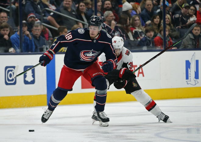 Blue Jackets center Pierre-Luc Dubois breaks away from Ottawa center Colin White during a game on Nov. 25.
