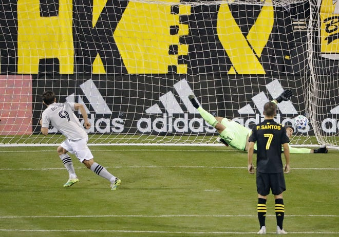 Montreal Impact forward Bojan Krkic scores on a penalty kick against Crew goalkeeper Andrew Tarbell for the winning goal on Wednesday in Mapfre Stadium.