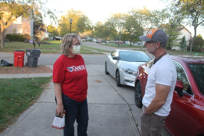 Republican state Rep. Laura Lanese, seeking reelection on Nov. 3, talks to Gene Marczika outside his Grove City home.