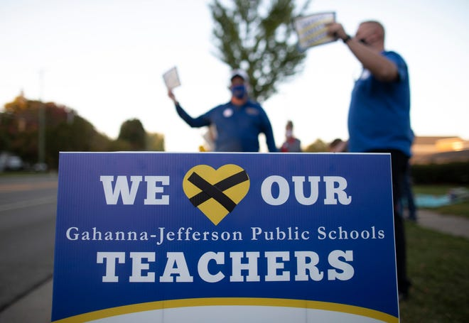Parents and teachers in the Gahanna-Jefferson Education Association rally for a new employment contract outside Gahanna Lincoln High School on Oct. 7. The strike lasted four school days.