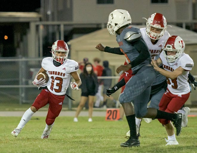 Tavares' Antony Burgos (13) runs with the ball during last week's game against Leesburg at H.O. Dabney Stadium in Leesburg. This week, Tavares plays at Umatilla and Leesburg travels to The Villages. [PAUL RYAN / CORRESPONDENT]