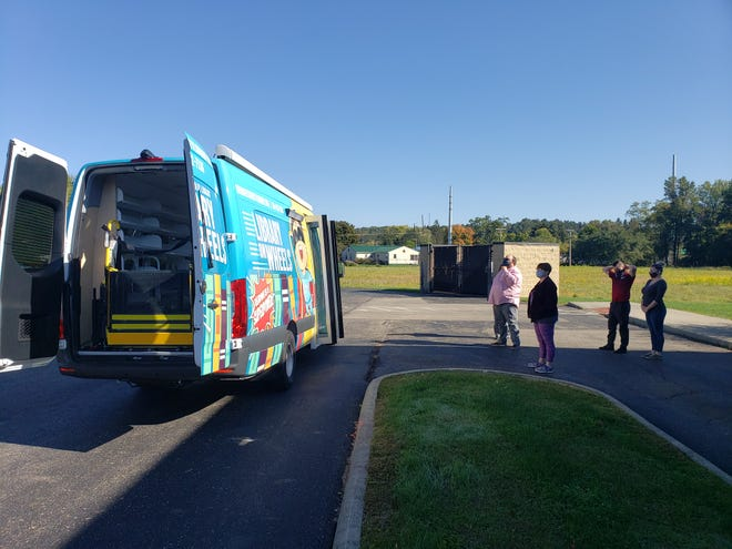 The staff of the Guernsey County Public Library gathered at the Crossroads branch to check out the new bookmobile as it arrived earlier this month.