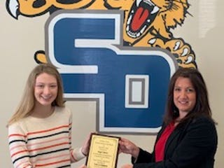 Suzette McIntyre (right), financial advisor with Edward Jones in Lexington, presents the Student Athlete of the Month Award to Angel Skeen of South Davidson High School.