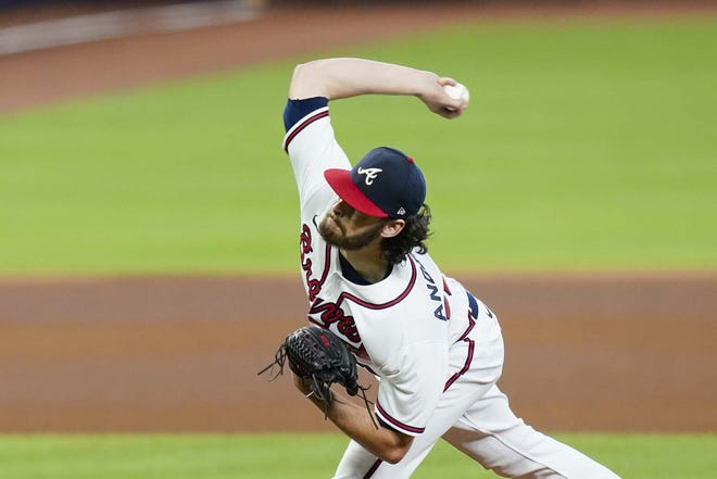Shenendehowa High School graduate Ian Anderson delivers a pitch for the Atlanta Braves during the fourth inning of Game 2 of a National League Division Series against the Miami Marlins Wednesday in Houston. [ERIC GAY / AP]