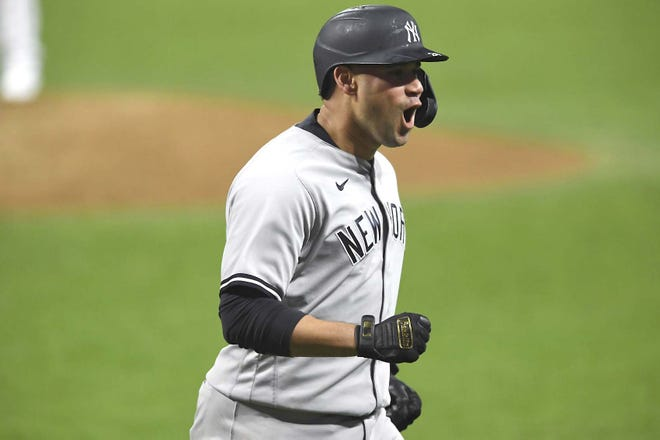 New York Yankee Gary Sanchez reacts after hitting a two-run home run Sept. 30 against Cleveland Indians relief pitcher Triston McKenzie during Game 2 of an American League wild card series in Cleveland. [DAVID DERMER / AP]