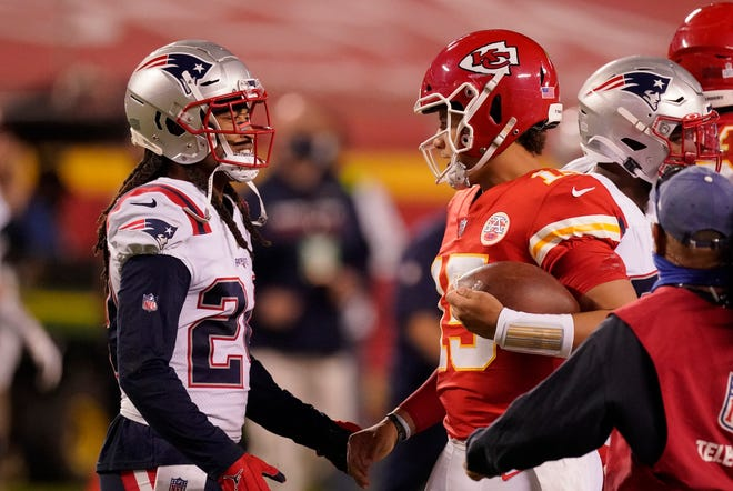 New England Patriots cornerback Stephon Gilmore, left, talks with Kansas City Chiefs quarterback Patrick Mahomes after Monday's game. Gilmore later tested positive for COVID-19,