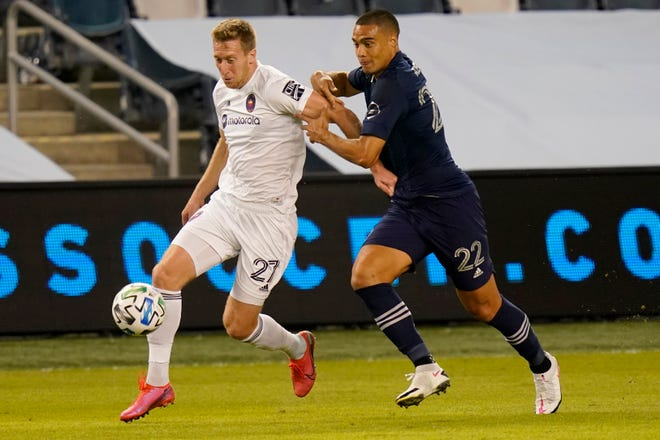 Sporting Kansas City's Winston Reid (22) pressures Chicago Fire forward Robert Beric (27) in the first half of Wednesday's game at Children's Mercy Park. Reid later scored his first MLS goal to lift Sporting to a 1-0 win.