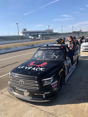 Devon Rouse of Burlington climbs into a NASCAR truck to turn a few laps in Charlotte, North Carolina.