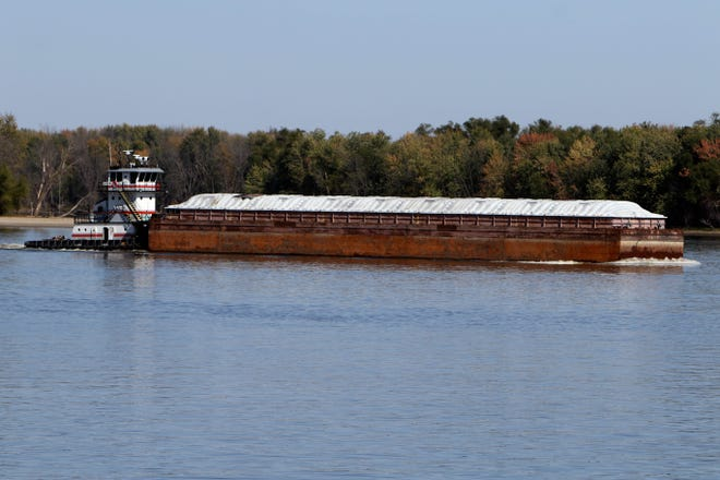 A barge travels the Mississippi River Wednesday near Burlington. The Mississippi River System, along with its connecting tributaries, is primarily used for transporting agricultural and manufactured goods across the span of the country.