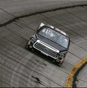 Devon Rouse of Burlington turns a lap in a NASCAR truck in Charlotte, North Carolina.