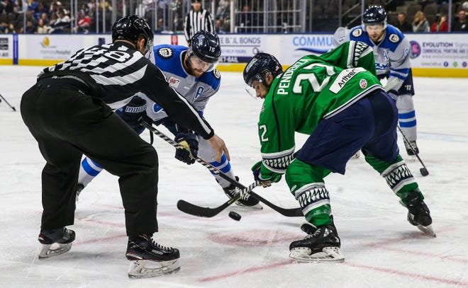 Jacksonville Icemen forward John Albert (16) and Florida Everblades forward Joe Pendenza (22) face off during an ECHL game on March 6, one week before the coronavirus pandemic ended the season. The ECHL plans to begin the 2020-21 campaign on Dec. 11.