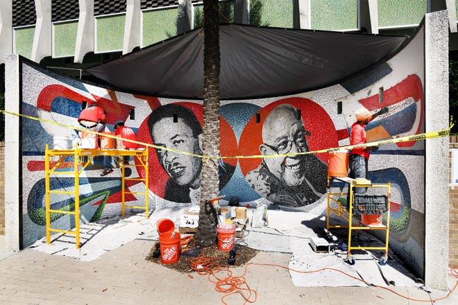 The team of artist Celso Gonzalez put the final touches on the first pair of mosaic portraits featuring civil rights leaders Rutledge Pearson and Rodney Hurst on Thursday.