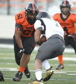 Massillon's Reece Turpin closes in on Columbus Bishop Sycamore's Daivon Lowman during a game Sept. 3, 2020.