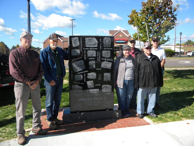 Members of the Nordonia Hills Veterans Memorial Park Foundation, which has spearheaded the effort to create the park over the last few years, were on hand when this monument and two others were installed Thursday, From left, Vice President Dan Davis, President Dave Pristash, Historian Kay Krasnicki, associate member Bob Zarle, Secretary Jim Krasnicki, and Treasurer Frank Posar.