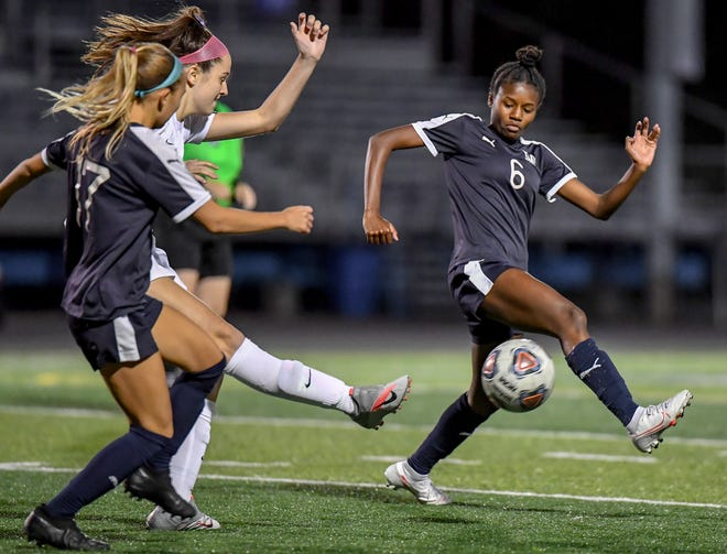 Twinsburg forward Jaydn Harris blocks a clearing attempt during the Tigers' 1-1 draw with Hudson Oct. 7 at Tiger Stadium.