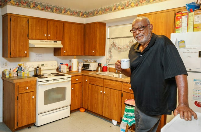 Lee Wilson, a Vietnam veteran, stands in the remodeled kitchen at his home in Lakeland. Lakeland Habitat for Humanity has a program that provides free home repairs for veterans and their families. Wilson recently had repairs done, including a roof replacement and repairs to a bathroom and the kitchen. He lives with his 92-year-old mother.