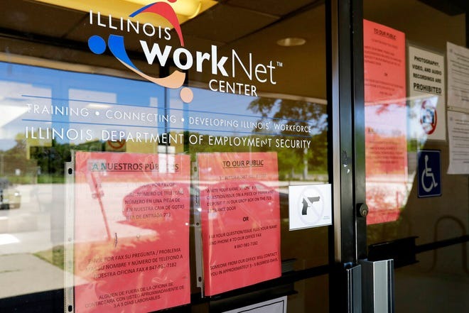 In this June 11, 2020, file photo, information signs are displayed at the closed Illinois Department of Employment Security WorkNet center in Arlington Heights, Ill. U.S. employers advertised for slightly fewer jobs in August while their hiring ticked up modestly. The Labor Department said Tuesday, Oct. 6, 2020, that the number of U.S. job postings on the last day of August dipped to 6.49 million, down from 6.70 million July.