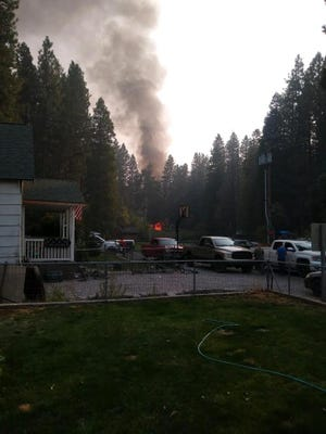 Smoke rises from a house fire on Sept. 30 in Carrick Addition.
