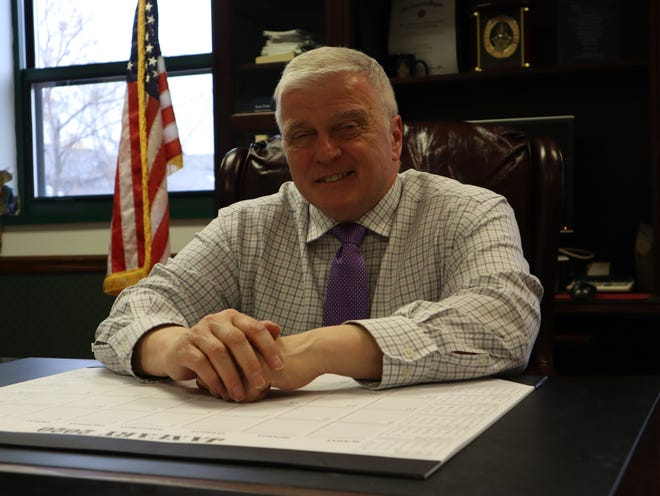 In this January file photo, Utica City Court Judge Ralph Eannace sits in his office. A state commission has recommended that Eannace should be admonished for failing to disclose financial reports in a timely manner.