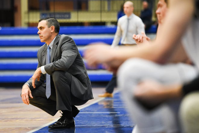 Hamilton College men's basketball coach Adam Stockwell looks on during a game in January 2020. Hamilton College announced Thursday it will not participate in winter sports because of the coronavirus pandemic.