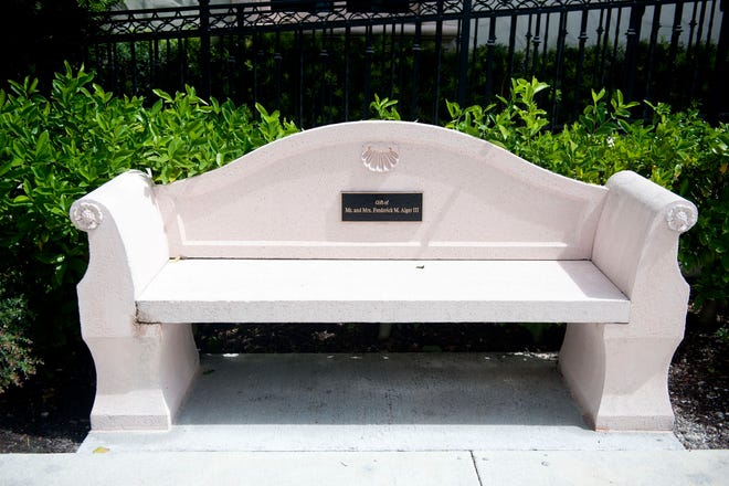A replacement cast concrete pink bench remained Tuesday in from of The Society of the Four Arts King Library.