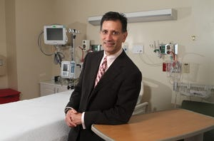 Dr. Michael Black in the pediatric intensive care unit at St. Mary's Medical Center before the pediatric heart surgery program was closed down following a CNN story. He is now suing the news network for defamation.