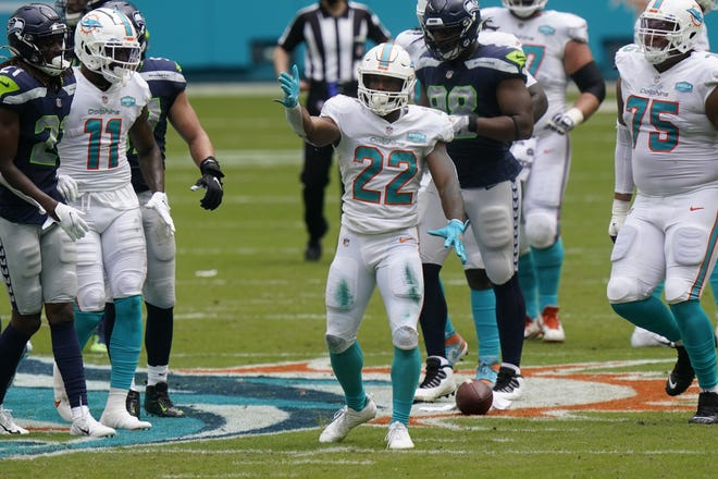 Dolphins running back Matt Breida, signaling a first down against the Seahawks last Sunday, gives the running game a burst of speed when he touches the ball.