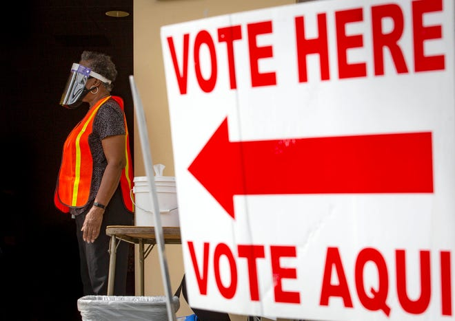 Volunteer Caroline Jackson waits for voters at the Wellington branch library's early voting site during the August 2020 primary election.