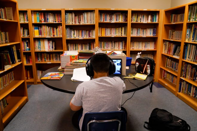 A Los Angeles Unified School District student attends an online class at the Boys & Girls Club of Hollywood in Los Angeles, where a group of parents have sued, alleging the district's distance learning program since the pandemic has failed to meet state standards or guarantee a basic education.