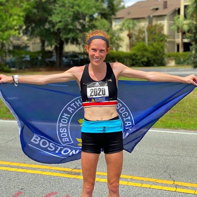 Megan Lavins of Hudson, a Kent Roosevelt High School graduate, celebrates after her career-best performance at the Boston Marathon Virtual race last month.