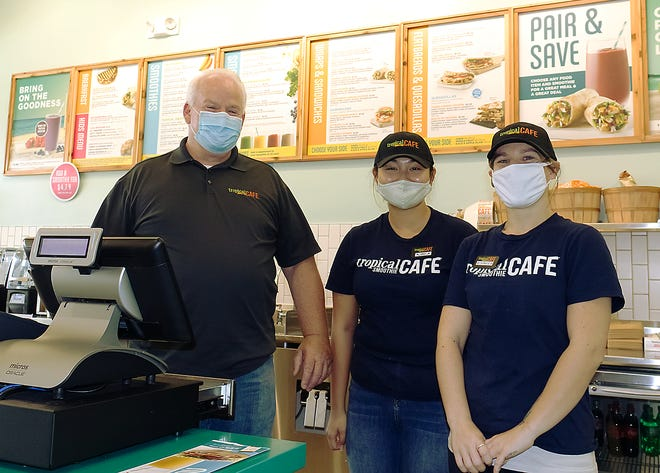 From left, Joe Dwyer, franchise owner of the new Tropical Smoothie Café, Janice Pham and Erica Cox are ready to serve up smoothies and a variety of healthy flatbread sandwiches, wraps and quesadillas at the new restaurant.