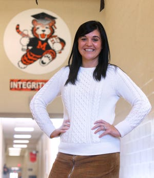 Amanda Williams, who teaches eighth-grade English Language Arts at Massillon Junior High School, is The Independent's Teacher of the Month. She was photographed at school on Wednesday.