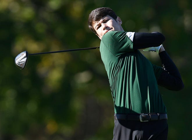 Central Catholic's Charlie Belden watches his tee shot on the No. 3 hole during last week's Division III district tournament at Tannenhauf.