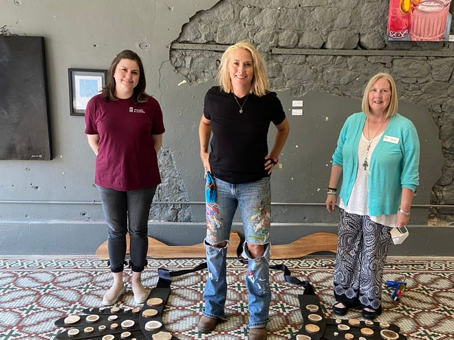 From left to right Shawnee attorney Breanne Gordon, Sherri Thompson with Community Renewal and local artist LeAnne Henry Wright have been working on an event to honor Justice Ruth Bader Ginsburg and empower young women in the community.