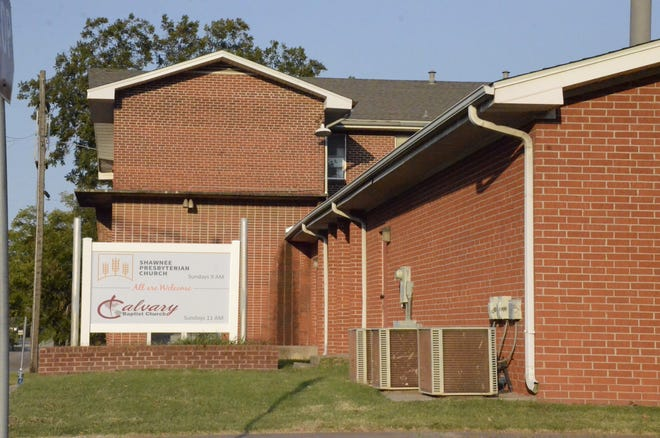 A sign outside a church building in Shawnee, Okla., advertises the home of two denominations as they share a common mission to serve the same neighborhood.