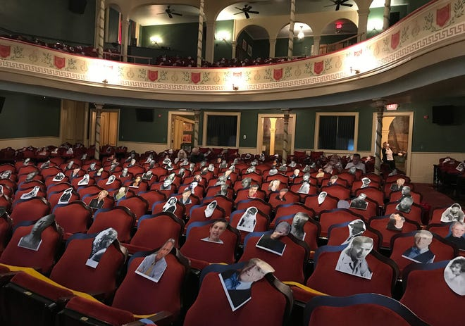 """Head shots of local and famous actors mark the """"off-limits"""" seats at Thalian Hall for a movie screening on Wednesday, Oct. 7. Oct. 5 was Thalian Hall's first day open in more than six months, when the pandemic shut down almost all arts events in Wilmington."""