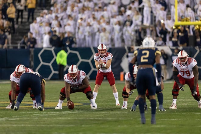 Redshirt freshman quarterback Devin Leary (13) threw for four touchdown passes in leading N.C. State to a 30-29 win at No. 24 Pitt last Saturday. (Photo courtesy of N.C. State Athletics)
