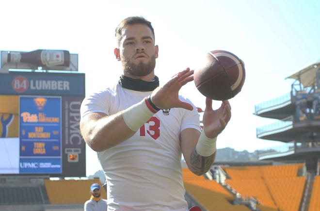 Oct 3, 2020; Pittsburgh, Pennsylvania, USA;  North Carolina State Wolfpack quarterback Devin Leary (13) warms up before playing the Pittsburgh Panthers at Heinz Field. Mandatory Credit: Charles LeClaire-USA TODAY Sports