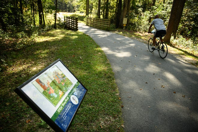StoryWalk at Clark Park Nature Center on Thursday, Oct. 8, 2020. The StoryWalk is a little over a mile and consists of each page of a picture book laminated and displayed along a walking trail so an adult and child can read the entire book together.