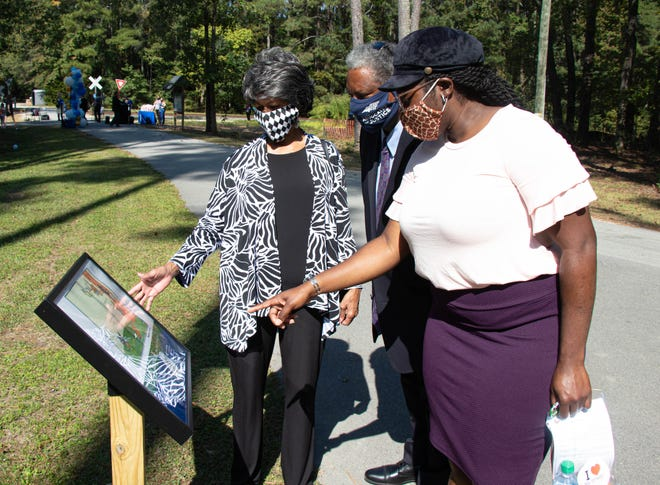 Members of the Cumberland County Board of Commissioners and the Fayetteville City Council explore the StoryWalk after the opening celebration at Clark Park on Oct. 7.
