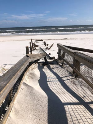 A trail of debris marks the place a boardwalk once stood at Perdido Key State Park's east beach access point. [Photo courtesy Florida Conservation Corps service members/Fresh Take Florida]