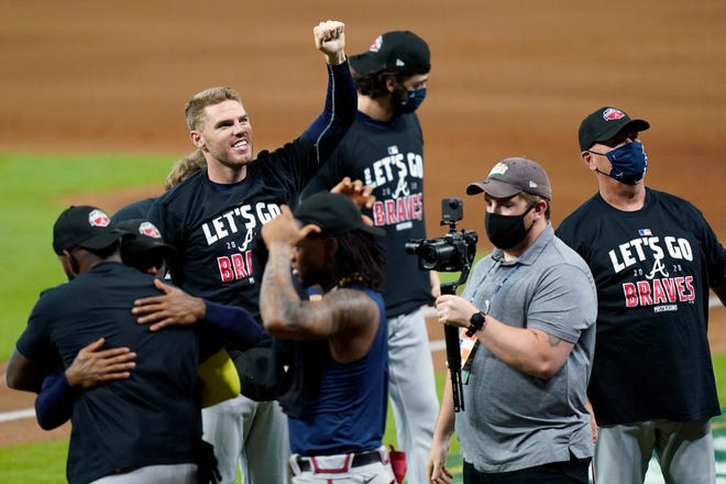 Atlanta's Freddie Freeman celebrates Thursday after the team's sweep of Miami in the NLDS.