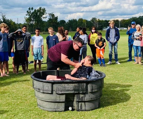 Thirteen Coosa Christian High School football players were baptized during a recent practice session at the school.