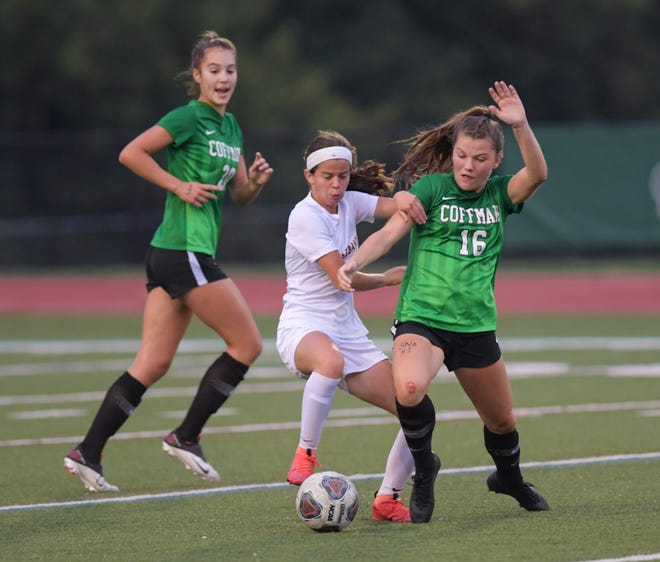 Coffman's Norah Roush (right) battles New Albany's Bella Haas during a game earlier this season as Bella Paoletti looks on. The Shamrocks, despite graduating several key players after reaching a Division I state semifinal, are having another strong season.