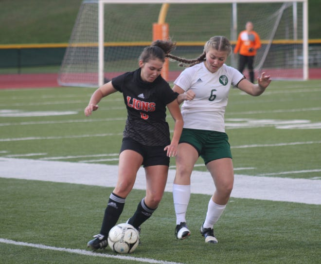 Wellsville's Carley Young, left, and Genesee Valley's Avery Grusendorf battle for possession Wednesday night.